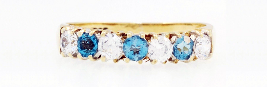 9ct Yellow Gold Simulated Blue Topaz & Simulated Diamond Eternity