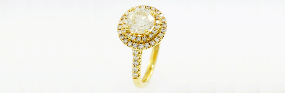 18Ct Yellow Gold Diamond Solitaire and Halo Cluster